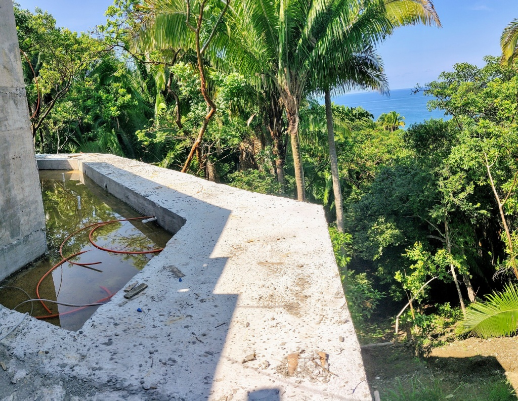 Kids swimming pool and balcony with ocean and jungle view